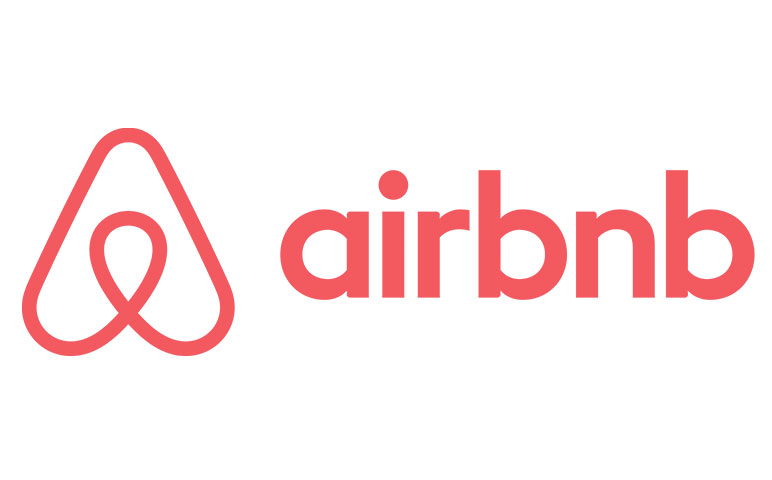airbnb logo partnered with socialtable